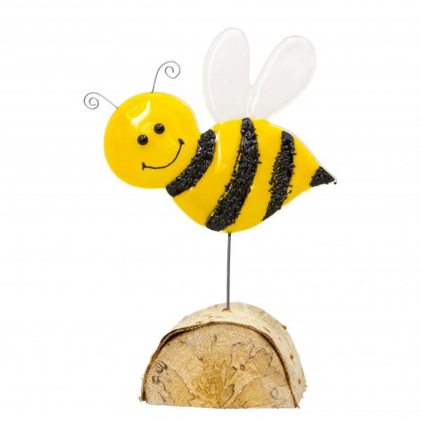 Biene auf Holzsockel
